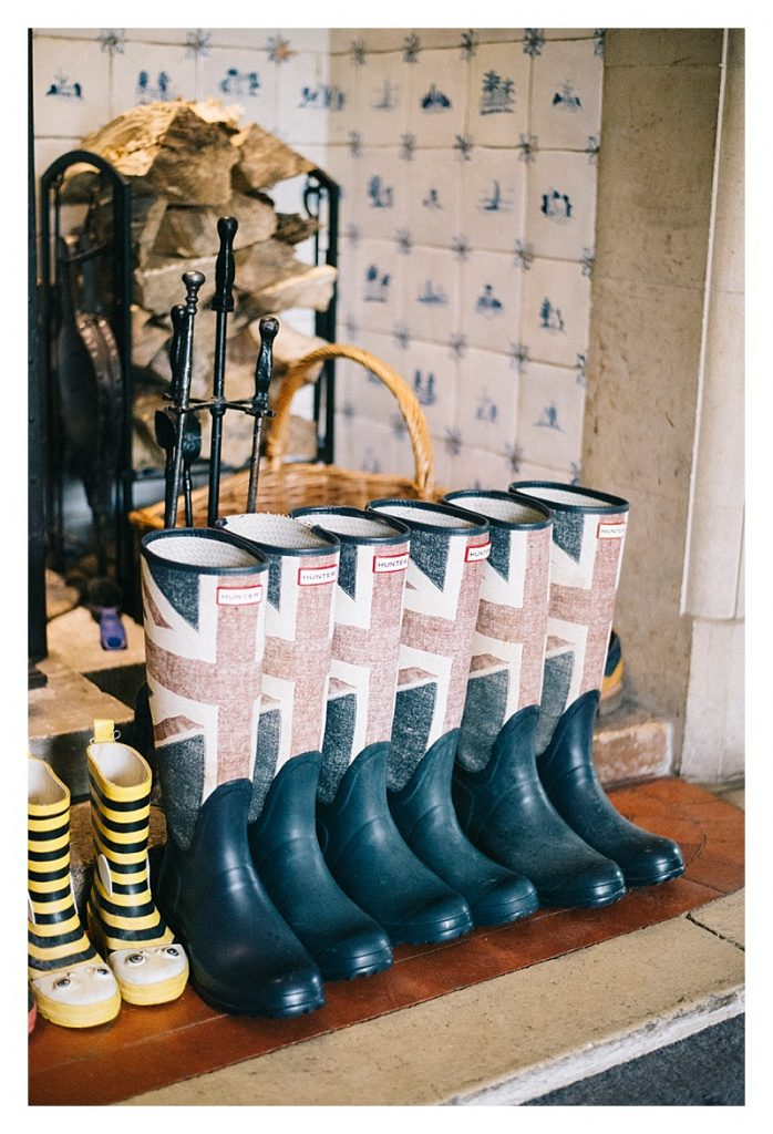 things we love about winter a row of blue and red hunter winter boots lined up near the fireplace