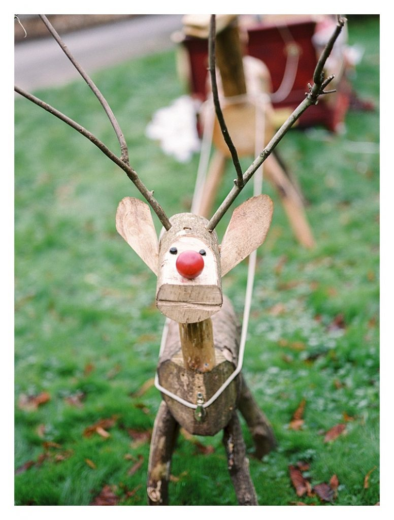things we love about winter a rustic wooden rudolf pulling a winter sleigh